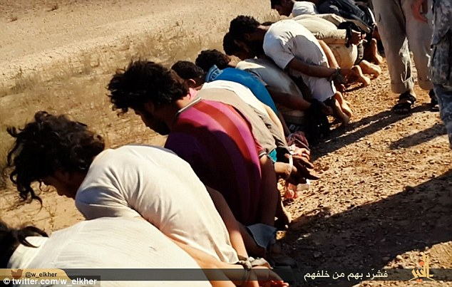 Crimes against humanity: The captives are then lined up and ordered to kneel down on the dusty ground