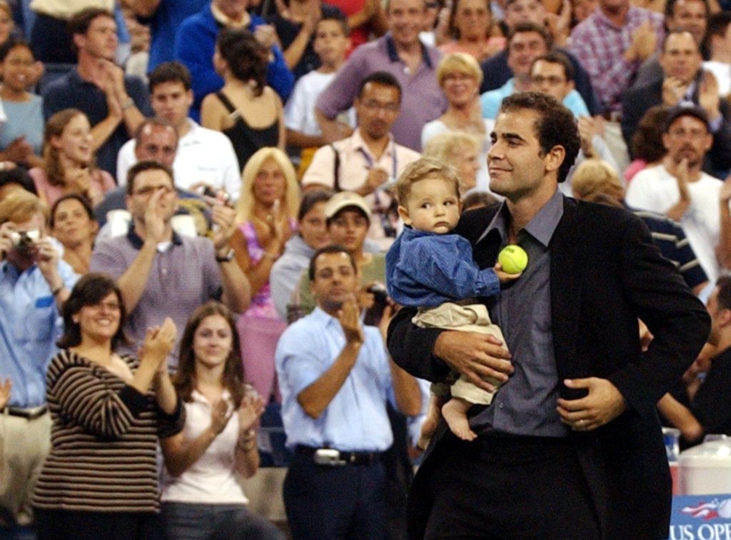 Pete Sampras takes a final lap around Arthur Ashe Stadium with his son Christian Charles after he announced his retirement from tennis on Monday, Aug. 25, 2003 at the US Open tennis tournament in New York. (AP Photo/Bill Kostroun)