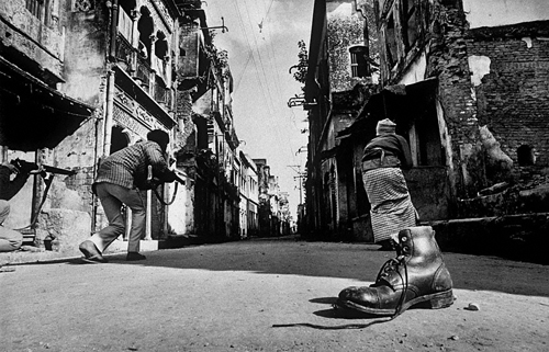 """...in a street of horror in the old quarter of the city I saw Mukti Bahini Guerrillas hunting snipers..."" - Kishor Parekh, Bangladesh War 1971."