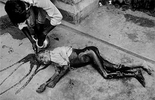 """...there were more innocent casualties. I came upon this half-naked boy lying in a pool of his own blood. An elderly man gently washed his head with water, then lifted him up - but where is safety to be found?""- Kishor Parekh, Bangladesh War 1971."