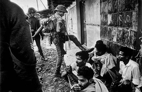 """...Indian troops grimly round up villagers suspected to be Pakistani spies...The Jawans (soldiers) I was travelling with weren't too gentle: they had suffered casualties...""- Kishor Parekh, Bangladesh War 1971."